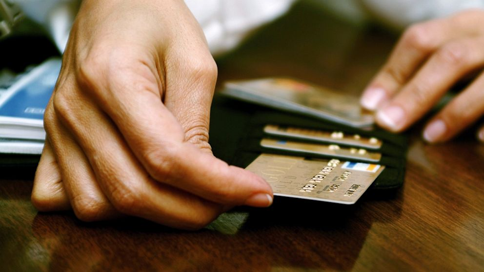 Woman Paying With Credit Card In Clothing Store Stock Footage Video 4998710 - Shutterstock
