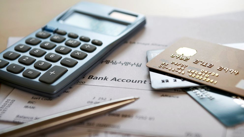 PHOTO: Follow these steps to help improve your credit score and debt.