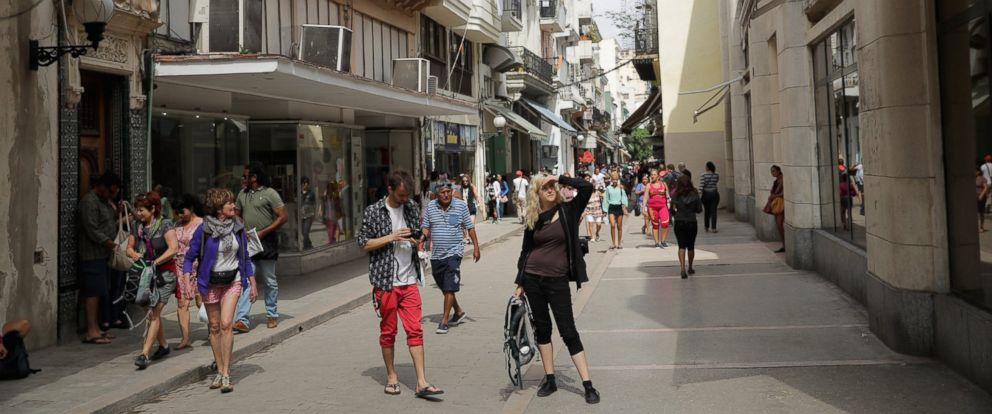 PHOTO: Tourists walk the narrow streets of the shopping district in the historic Habana Vieja, or Old Havana, March 21, 2016 in Havana, Cuba.
