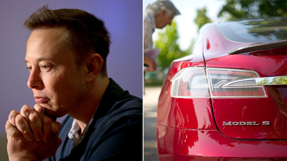 PHOTO: Elon Musk, left, co-founder and chief executive officer of Tesla Motors Inc., pauses during an interview at the companys assembly plant in Fremont, Ca