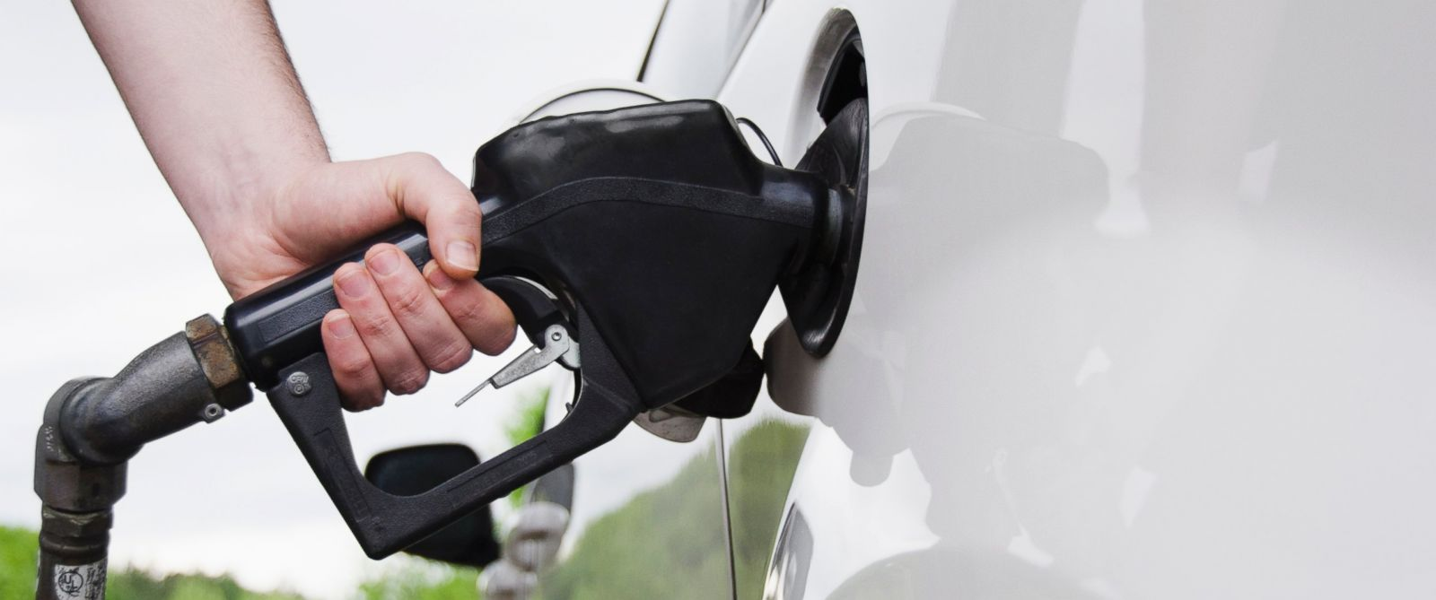 PHOTO: A man holding a gas pump refuels his car in this undated stock photo.