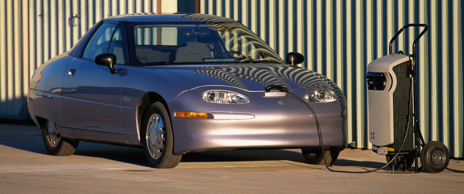 PHOTO: Silver Saturn EV-1 Electric Car on at a charging station is seen in this 1997 file photo.