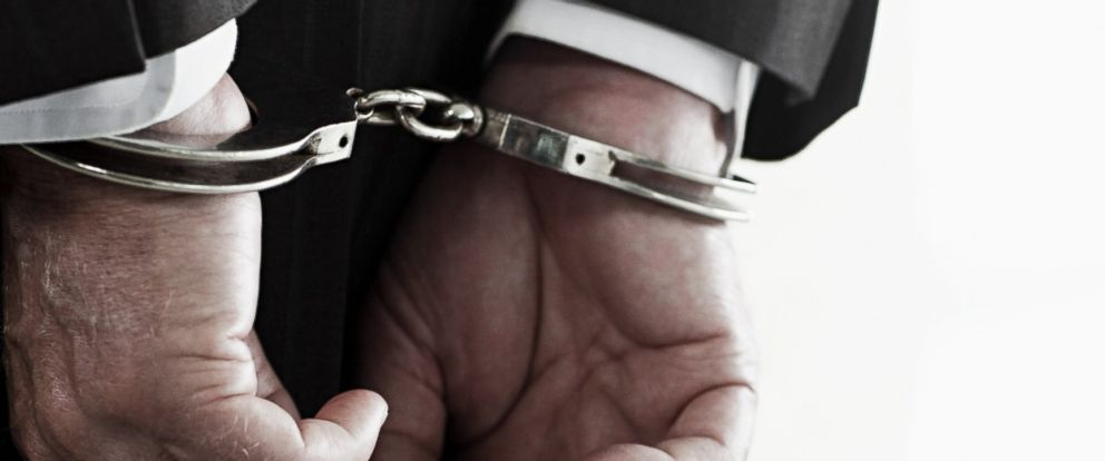 PHOTO: In this stock image, a businessman in handcuffs is pictured.