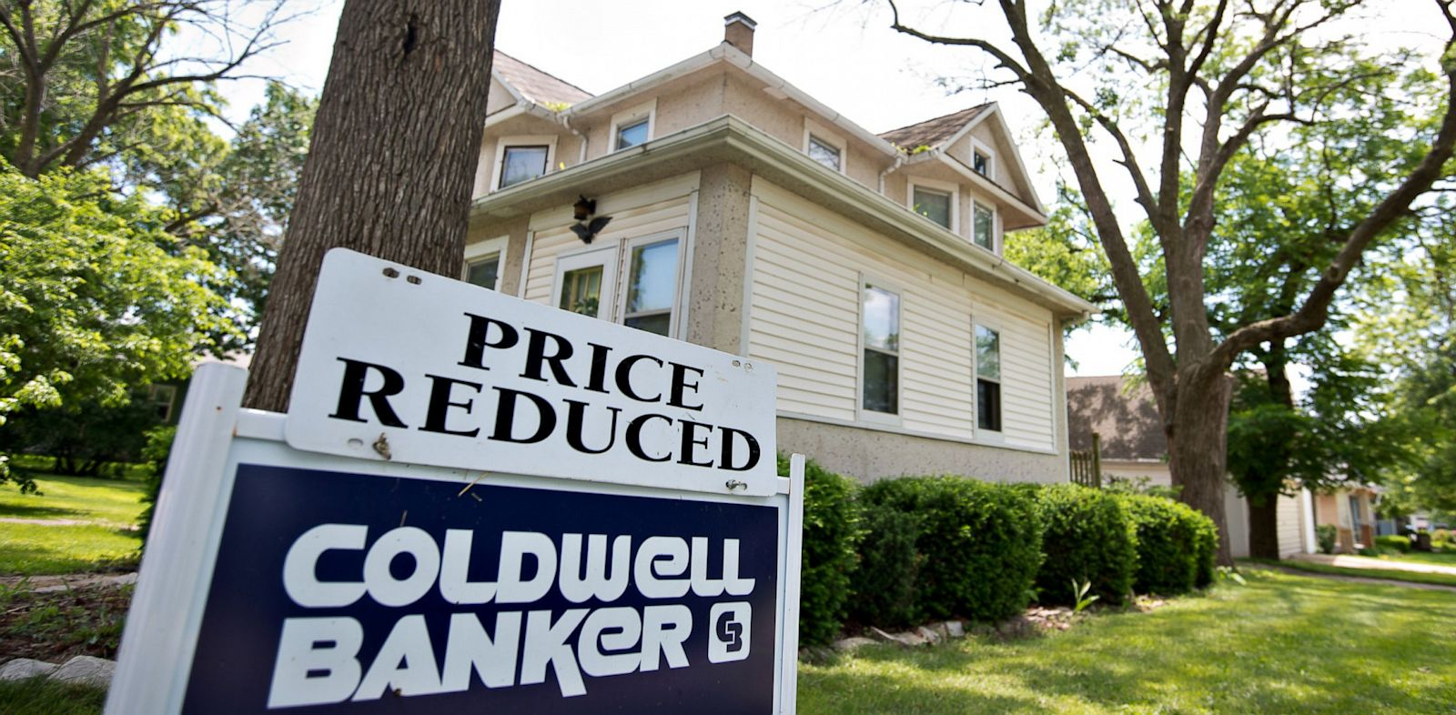 "PHOTO: A ""price reduced"" sign stands outside a home for sale in LaSalle, Illinois, June 7, 2013."