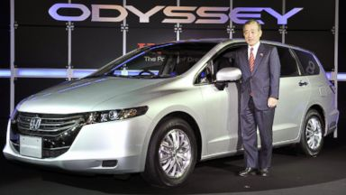 PHOTO: Japans auto giant Honda Motor president Takeo Fukui displays the fourth generation model of the companys mini-van Odyssey in Tokyo on Oct. 16, 2008.