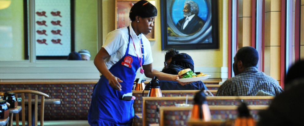 PHOTO: A waitress serves customers at IHOP, Feb. 16, 2012, in Washington, DC.