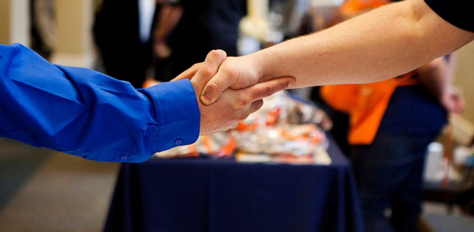 PHOTO: A job seeker shakes hands with a representative at the Recruit Military veteran job fair in San Diego, Feb. 27, 2014.