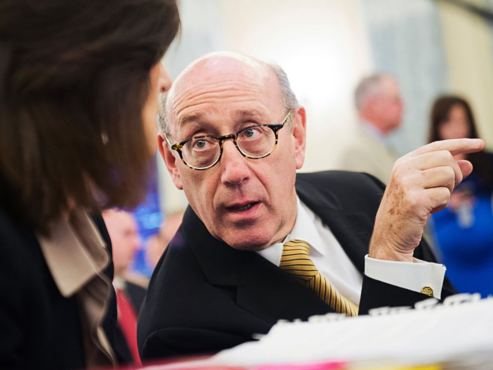 PHOTO: Ken Feinberg talks with colleague Camille Biros in Washington, July 17, 2014.