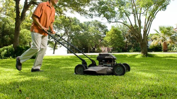 PHOTO: In this stock image, a man is pictured mowing a lawn.