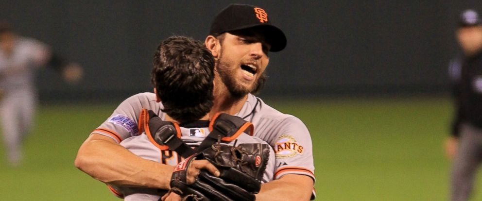 PHOTO: Buster Posey, left, and Madison Bumgarner, right, of the San Francisco Giants celebrate after defeating the Kansas City Royals to win Game Seven of the 2014 World Series on Oct. 29, 2014 in Kansas City, Mo.