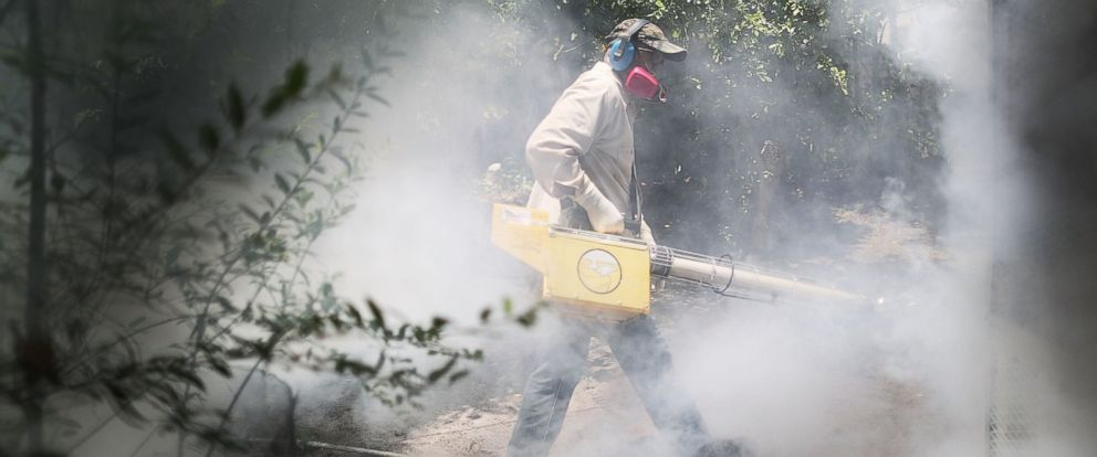 PHOTO: Carlos Varas, a Miami-Dade County mosquito control inspector, uses a Golden Eagle blower to spray pesticide to kill mosquitoes in the Wynwood neighborhood as the county fights to control the Zika virus outbreak, Aug. 2, 2016 in Miami.