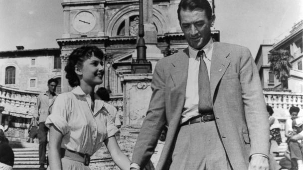 PHOTO: Audrey Hepburn holds hands with Gregory Peck in a scene from the film Roman Holiday, 1953.