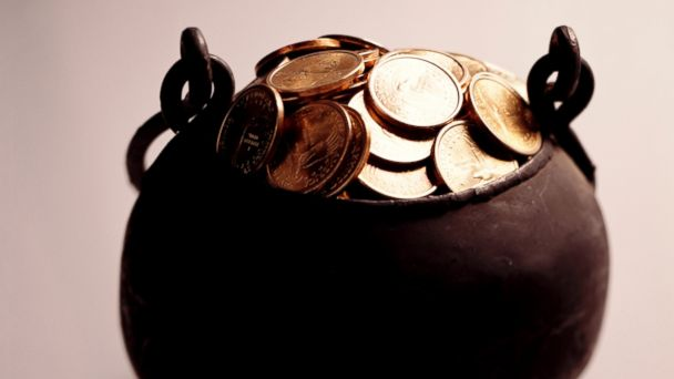 PHOTO: In this stock image, a pot of gold coins is pictured.