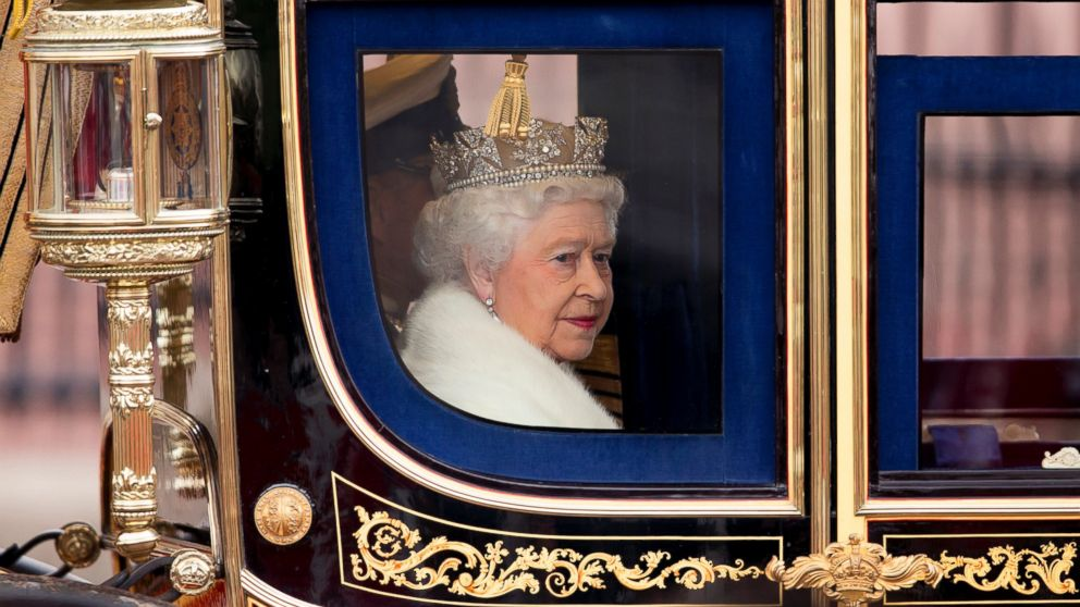 PHOTO: Queen Elizabeth II travels in a horse drawn carriage from Buckingham Palace to attend the State Opening of Parliament, May 8, 2013 in London, England.