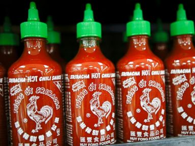PHOTO: Huy Fong Foods Inc. Sriracha sauce is displayed for sale during the grand opening of a Wal-Mart Stores Inc. location in the Chinatown neighborhood of Los Angeles, Calif. Sept. 19, 2013.