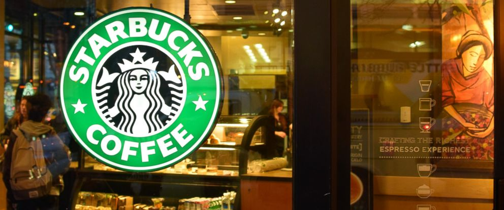 PHOTO: A glowing Starbucks Coffee sign hangs in the window of a store in downtown Seattle, Jan. 28, 2015.
