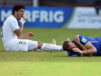 FIFA Suspends and Fines Suarez After Biting Player