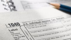 PHOTO: In this stock image, a 1040 tax form is pictured.