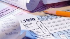 PHOTO: Tax forms, pencil and receipts are seen in this undated file photo.