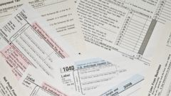 PHOTO: In this stock image, a pile of tax forms are pictured.