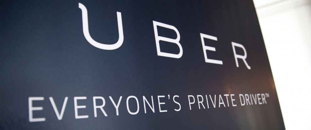 PHOTO: Uber Technologies Inc. signage stands inside the companys office in Washington, March 24, 2016.