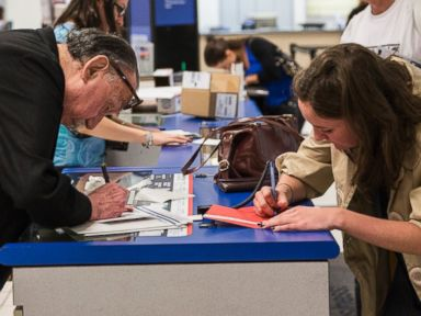 PHOTO: People write addresses on envelopes and packages at a United States Post Office in New York, Sept. 25, 2013.