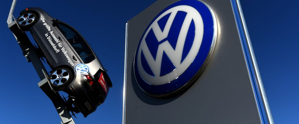 PHOTO: A model and logo of German car maker Volkswagen are seen at the entrance to a VW branch in Duesseldorf, Germany on Sept. 28, 2015.