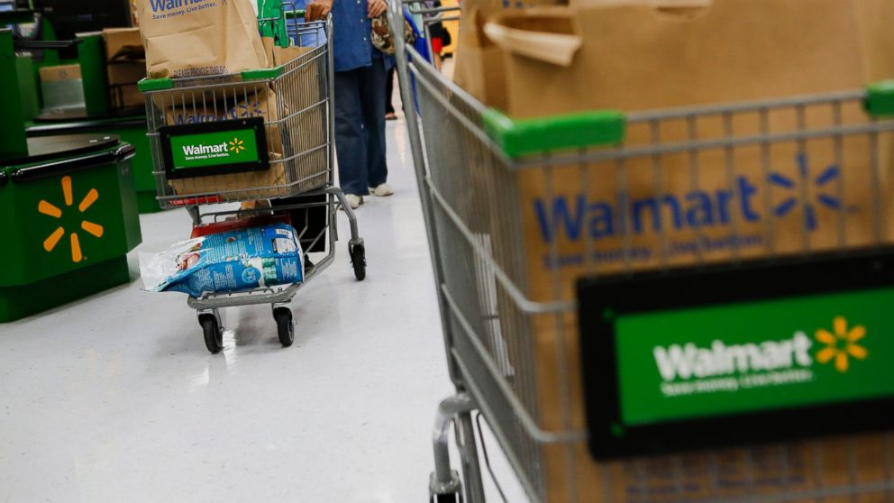 PHOTO: Customers push shopping carts at a Wal-Mart