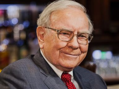 PHOTO: Warren Buffett, chairman and chief executive officer of Berkshire Hathaway Inc., smiles during a Bloomberg Television Interview in New York, U.S., on April 23, 2014.