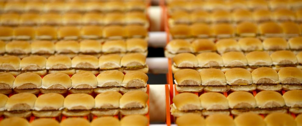 PHOTO: White Castle hamburger Sliders move down a conveyor belt before being frozen, packaged, and shipped to grocery stores at the new White Castle Co. Distributing Plant in Vandalia, Ohio, April 30, 2014.