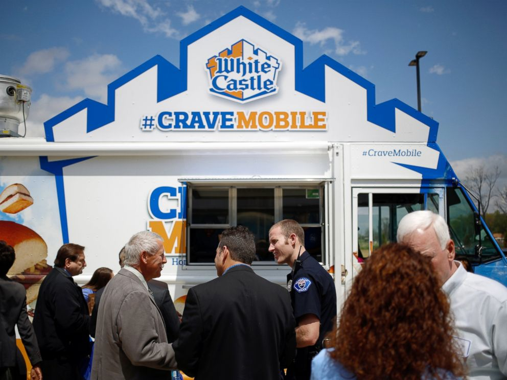 PHOTO: Attendees of the grand opening for the new White Castle Co. Distributing Plant stand in line at the White Caste Cravemobile food truck in Vandalia, Ohio, April 30, 2014.