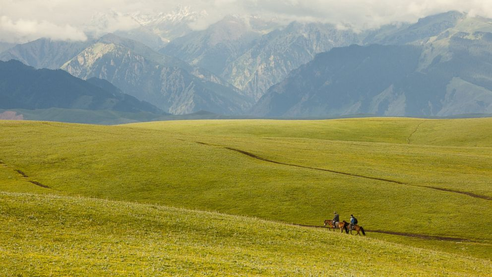 PHOTO: Horsemen travel through the Kalajun Mountain Area in Xinjiang.