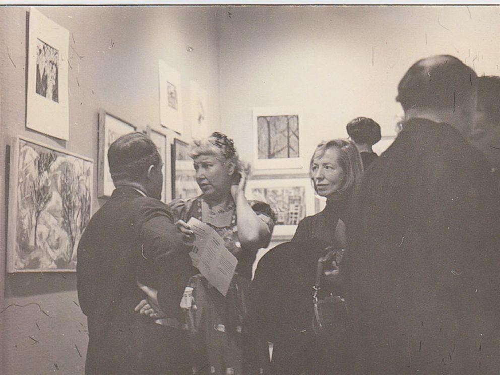 PHOTO: Jenifer Gordon (Walker) and Hazel Guggenheim McKinley admiring artwork.