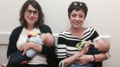 PHOTO: Abby Koenig, left pictured with her sister as they hold her twins Jack, left, and Levi, right.