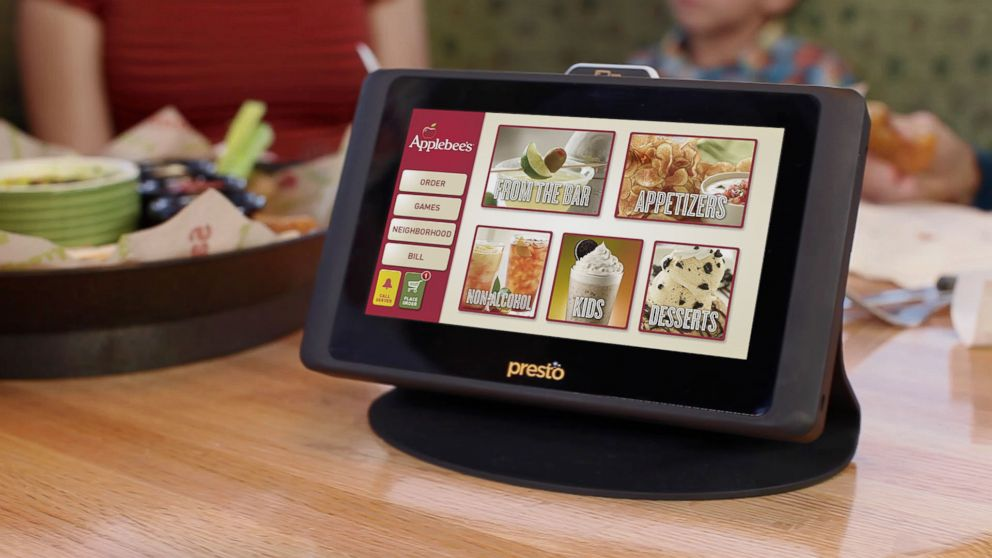 PHOTO: Applebees intends to put a tablet computer on all its restaurant tables in the US. The Presto tablets will allow diners to play games, learn more about menu and pay the check.