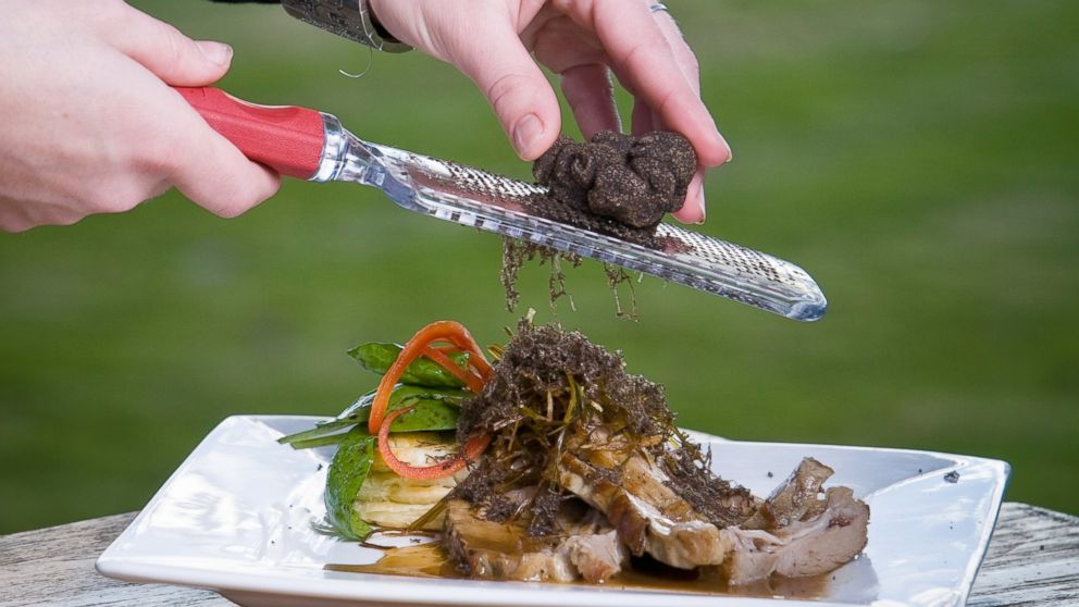 PHOTO: Truffles are shaved over a plate of food.