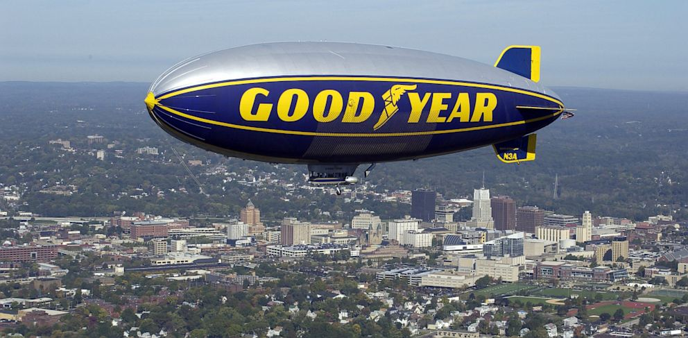 PHOTO: The Goodyear Blimp Stars and Stripes flying over the Akron skyline.