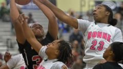 PHOTO: Narbonne and View Park players jump for a ball during the L.A. City Section Girls Basketball Open Division Quarterfinal in Los Angeles, Feb. 28, 2015.