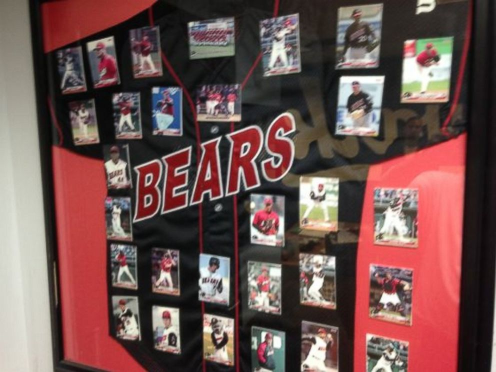 PHOTO: A Newark Bears framed black jersey, the teams 2005-2008 design, with trading cards of the teams players mounted above it, as part of a liquidation sale by the Newark Bears.