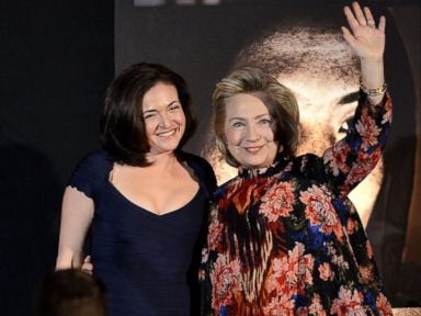 PHOTO: Sheryl Sandberg and Hillary Clinton onstage at the Women for Women 20th Anniversary Gala celebration at the American Museum of Natural History, Dec. 3, 2013, in New York City.