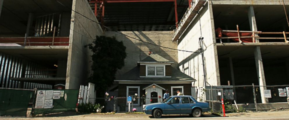 PHOTO: Edith Macefields house is seen while construction goes on around it.