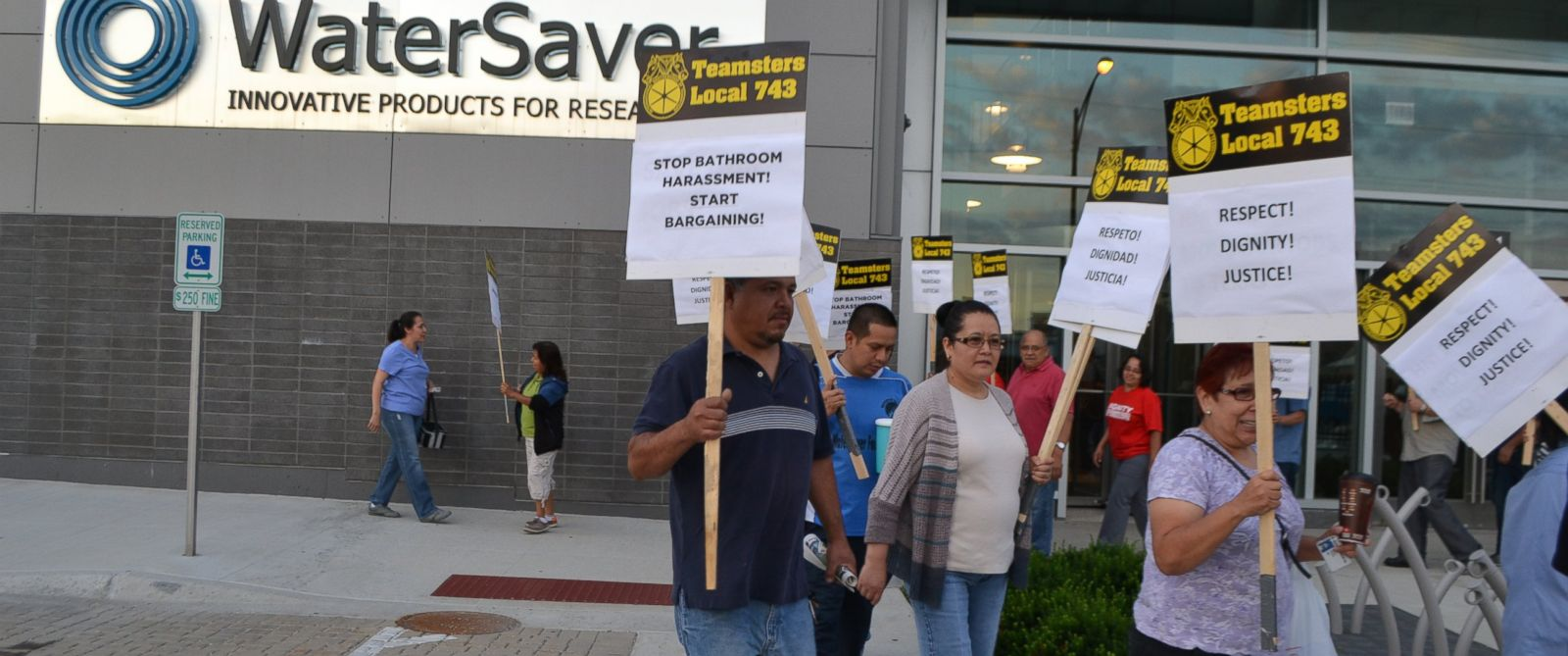 """PHOTO: Members of the Teamsters Local 743 chapter participate in a """"Stop Bathroom Harassment, Start Bargaining"""" rally in front faucet maker WaterSaver in Chicago."""