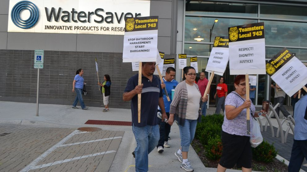 "PHOTO: Members of the Teamsters Local 743 chapter participate in a ""Stop Bathroom Harassment, Start Bargaining"" rally in front faucet maker WaterSaver in Chicago."