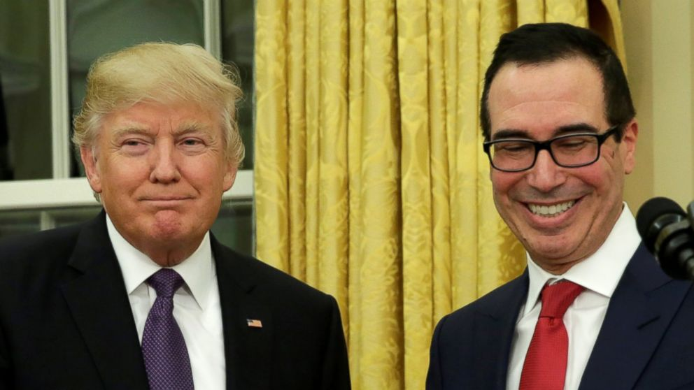 PHOTO: Steve Mnuchin (R) smiles next to U.S. President Donald Trump after being sworn in as Treasury Secretary in the Oval Office of the White House, Feb. 13, 2017, in Washington.