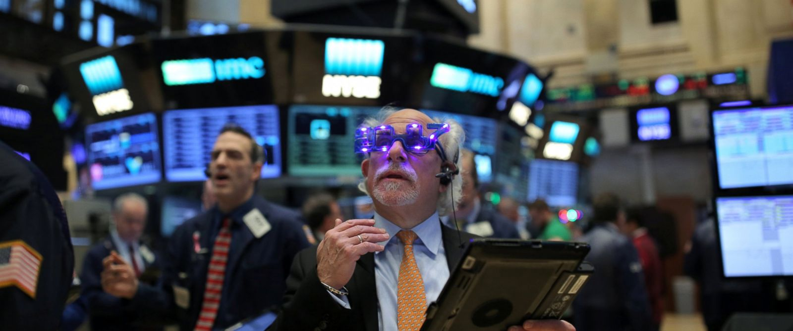 "PHOTO: A trader wears glasses that say ""2017"" ahead of the new year on the floor of the New York Stock Exchange in Manhattan, New York City, Dec. 30, 2016."