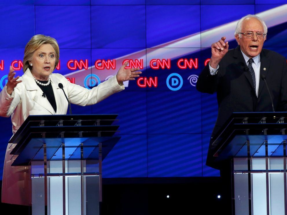 PHOTO: Democratic U.S. presidential candidates Hillary Clinton (L) and Senator Bernie Sanders speak simultaneously during a Democratic debate hosted by CNN and New York One at the Brooklyn Navy Yard in New York on April 14, 2016.