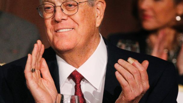 PHOTO: David Koch, executive vice president of Koch Industries, applauds during an Economic Club of New York event in New York, Dec.10, 2012.