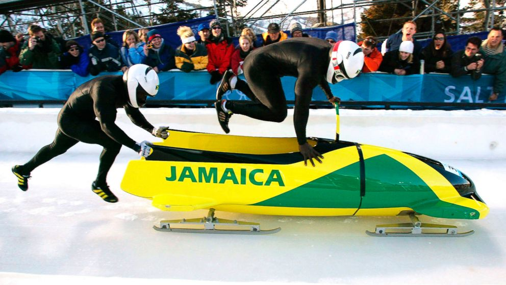 PHOTO: Lascelles Oneil Brown, left, and Winston Alexander Watt of the Jamaica-1 team leap into their sled at the start of heat three of the two-man bobsleigh competition at the Salt Lake 2002 Winter Olympic Games, Feb. 17, 2002 in Park City, Utah.