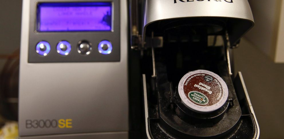 PHOTO: A Keurig Green Mountain brewing machine is seen before dispensing coffee in New York