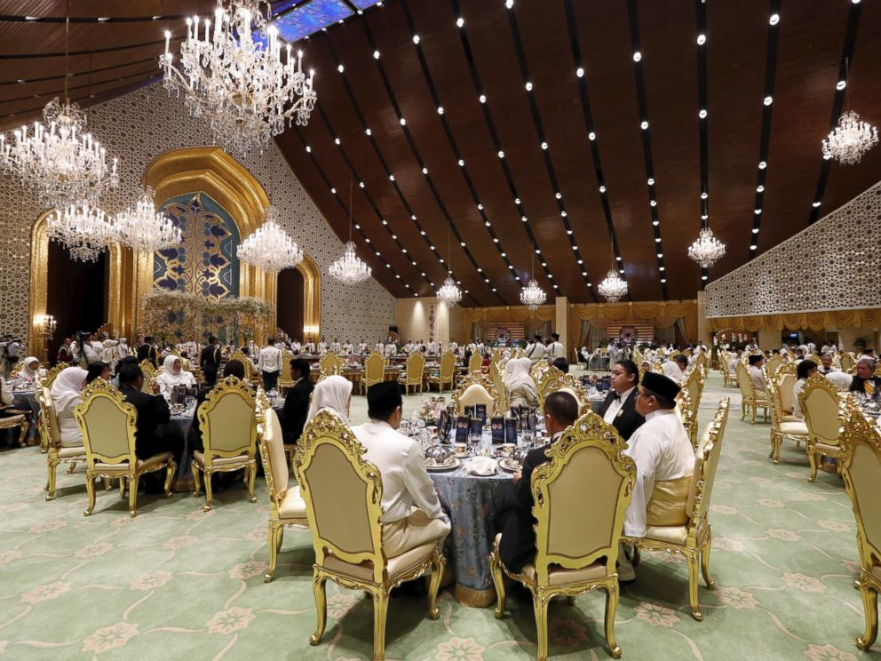 PHOTO: Guests at the wedding banquet for Bruneis newly wed royal couple, Prince Abdul Malik and Dayangku Raabiatul Adawiyyah Pengiran Haji Bolkiah, at the Nurul Iman Palace in Bandar Seri Begawan April 12, 2015.